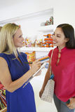 Saleswoman Communicating With Female Customer In Store Royalty Free Stock Photo