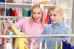 Saleswoman and customer choose clothes Stock Photo