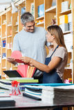 Saleswoman And Customer Holding Greeting Card Royalty Free Stock Photo