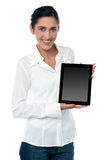 Saleswoman displaying new touch pad device Royalty Free Stock Photo