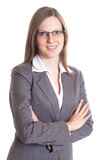 Saleswoman with eyeglasses and crossed arms in a grey jacket Stock Image