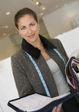 Saleswoman With Fabric Swatches And Daily Planner In Store Stock Image