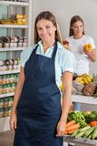 Saleswoman With Female Customer Shopping In Royalty Free Stock Photography