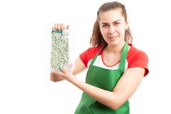 Saleswoman or female shop assistant presenting frozen product royalty free stock photography