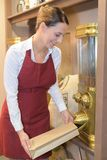 Saleswoman filling coffee beans in bag. Saleswoman filling coffee beans in a bag Stock Photography