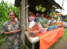 Saleswoman of fruit Royalty Free Stock Photography