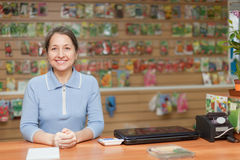 Saleswoman at garden store Royalty Free Stock Photo