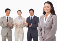 Saleswoman getting applause from her colleagues. Against a white background royalty free stock images