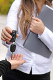Saleswoman handing over the keys to a car Royalty Free Stock Photo