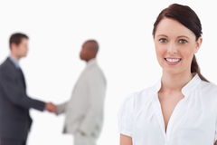 Saleswoman with hands shaking trading partners Royalty Free Stock Images