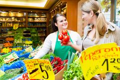 Saleswoman helping woman shopping groceries Stock Photo