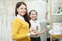 Saleswoman helps bride chooses bridal accessories Royalty Free Stock Image