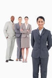Saleswoman with her team behind her Royalty Free Stock Images