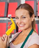 Saleswoman Holding Air Compressor Hose In Shop Stock Photography
