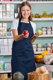 Saleswoman Holding Apples In Supermarket Stock Image