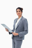 Saleswoman holding clipboard Royalty Free Stock Photo