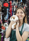 Saleswoman Holding Cute Guinea Pig At Store Stock Image