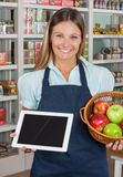 Saleswoman Holding Digital Tablet And Fruits Royalty Free Stock Photo
