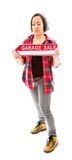 Saleswoman holding a Garage sale sign Royalty Free Stock Image