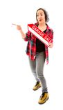 Saleswoman holding a Garage sale sign and pointing Royalty Free Stock Photos