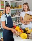 Saleswoman Holding Vegetable Basket Stock Image
