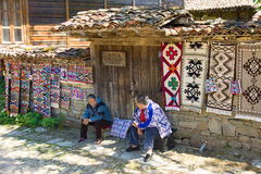 Saleswoman home carpet in the Bulgarian village of Zheravna. Mountain eco-village Zheravna - Bulgarian national carpet center, rural tourism, national rural royalty free stock photos
