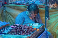 saleswoman of jewelry and amulets stock photography