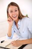Saleswoman making notes in agenda Royalty Free Stock Image