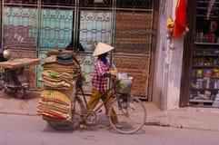 Saleswoman of mats stock photo