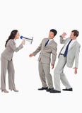 Saleswoman with megaphone yelling at colleagues. Against a white background Royalty Free Stock Photography