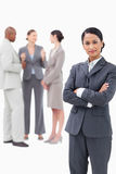 Saleswoman with negotiating trading partners behind her Royalty Free Stock Photo
