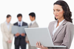Saleswoman with notebook and colleagues behind her Stock Images
