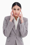 Saleswoman novo com dor de cabeça Imagem de Stock