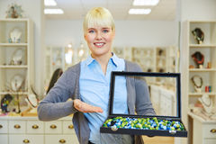 Saleswoman offering jewelry Stock Photos