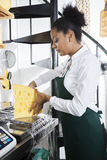 Saleswoman Packing Cheese At Counter In Grocery Store Royalty Free Stock Photos