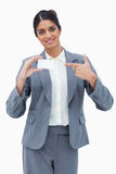 Saleswoman pointing at blank business card Stock Images