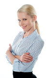 Saleswoman posing in style, arms-folded Stock Photos