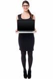 Saleswoman presenting brand new laptop Stock Image