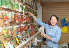 Saleswoman with seeds at store Royalty Free Stock Photo