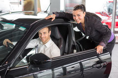 Saleswoman selling a car to happy customer Stock Photo