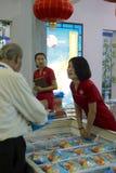 saleswoman selling fish balls Stock Image