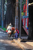 Saleswoman selling Vietnamese baguette bread is sitting on the street to wait buyer at center f Saigon ( Ho Chi Minh City ) , Viet Royalty Free Stock Image