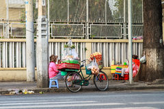 Saleswoman selling Vietnamese baguette bread is sitting on the street to wait buyer at center of Saigon, Vietnam Stock Photos
