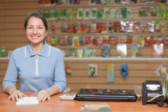 Saleswoman at shop for gardener Royalty Free Stock Photos