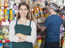 Saleswoman Standing Arms Crossed While Customer Selecting Produc Stock Photos