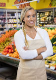 Saleswoman Standing Arms Crossed By Fruit Crates Royalty Free Stock Photo