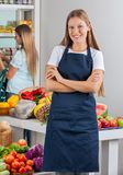 Saleswoman Standing Arms Crossed With Woman Royalty Free Stock Image