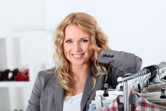 Saleswoman standing in store Royalty Free Stock Image