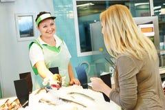 Saleswoman in supermarket shop Stock Photos