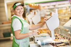 Saleswoman in supermarket shop Stock Images